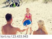 Купить «happy family playing with inflatable ball on beach», фото № 23433943, снято 11 августа 2015 г. (c) Syda Productions / Фотобанк Лори