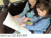 Купить «happy family with travel map driving in car», фото № 23433991, снято 12 июня 2016 г. (c) Syda Productions / Фотобанк Лори
