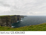 Купить «cliffs of moher and atlantic ocean in ireland», фото № 23434043, снято 23 июня 2016 г. (c) Syda Productions / Фотобанк Лори