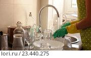 Купить «housewife in rubber gloves washing dishes», видеоролик № 23440275, снято 7 августа 2016 г. (c) Яков Филимонов / Фотобанк Лори