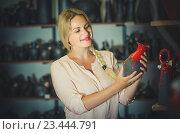 Купить «young woman selecting ceramics with red enamel in atelier», фото № 23444791, снято 24 сентября 2018 г. (c) Яков Филимонов / Фотобанк Лори