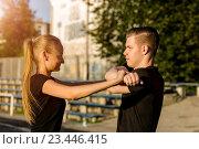 Купить «Молодые счастливые подростки разминаются на открытом воздухе», фото № 23446415, снято 3 июля 2016 г. (c) Pavel Biryukov / Фотобанк Лори