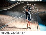 Купить «Man with cycle», фото № 23458167, снято 12 мая 2016 г. (c) Raev Denis / Фотобанк Лори
