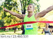 Купить «happy young male runner winning on race finish», фото № 23460531, снято 16 августа 2015 г. (c) Syda Productions / Фотобанк Лори