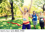 Купить «happy young female runner winning on race finish», фото № 23460799, снято 16 августа 2015 г. (c) Syda Productions / Фотобанк Лори