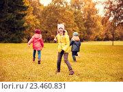 Купить «group of happy little kids running outdoors», фото № 23460831, снято 10 октября 2015 г. (c) Syda Productions / Фотобанк Лори