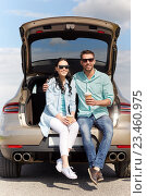 Купить «happy couple with coffee at hatchback car trunk», фото № 23460975, снято 12 июня 2016 г. (c) Syda Productions / Фотобанк Лори