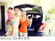 Купить «happy family with hatchback car at home parking», фото № 23461075, снято 11 августа 2015 г. (c) Syda Productions / Фотобанк Лори