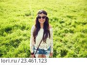 Купить «smiling young hippie woman on green field», фото № 23461123, снято 27 августа 2015 г. (c) Syda Productions / Фотобанк Лори
