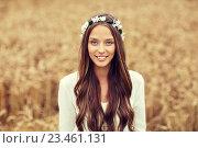 Купить «smiling young hippie woman on cereal field», фото № 23461131, снято 27 августа 2015 г. (c) Syda Productions / Фотобанк Лори