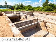 Купить «View of construction site and house foundation in preparation process», фото № 23462843, снято 3 июля 2016 г. (c) FotograFF / Фотобанк Лори