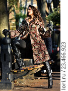 Купить «Elegant brunette model wearing coat and high heel boots posing at Central Park New York location for fall fashion photo shoot.», фото № 23466923, снято 15 ноября 2015 г. (c) Anton Oparin / Фотобанк Лори