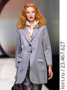 Купить «MILAN, ITALY - SEPTEMBER 25: A model walks the runway during the Emporio Armani show as a part of Milan Fashion Week Spring/Summer 2016 on September 25, 2015 in Milan, Italy.», фото № 23467627, снято 25 сентября 2015 г. (c) Anton Oparin / Фотобанк Лори