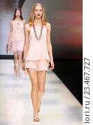 Купить «MILAN, ITALY - SEPTEMBER 25: A model walks the runway during the Emporio Armani show as a part of Milan Fashion Week Spring/Summer 2016 on September 25, 2015 in Milan, Italy.», фото № 23467727, снято 25 сентября 2015 г. (c) Anton Oparin / Фотобанк Лори
