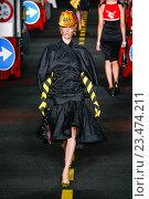 Купить «MILAN, ITALY - SEPTEMBER 24: A model walks the runway during the Moschino show as a part of Milan Fashion Week Spring/Summer 2016 on September 24, 2015 in Milan, Italy.», фото № 23474211, снято 24 сентября 2015 г. (c) Anton Oparin / Фотобанк Лори