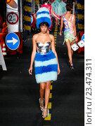 Купить «MILAN, ITALY - SEPTEMBER 24: A model walks the runway during the Moschino show as a part of Milan Fashion Week Spring/Summer 2016 on September 24, 2015 in Milan, Italy.», фото № 23474311, снято 24 сентября 2015 г. (c) Anton Oparin / Фотобанк Лори