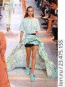 Купить «MILAN, ITALY - SEPTEMBER 26: A model walks the runway during the Roberto Cavalli fashion show as part of Milan Fashion Week Spring/Summer 2016 on September 26, 2015 in Milan, Italy.», фото № 23475155, снято 26 сентября 2015 г. (c) Anton Oparin / Фотобанк Лори