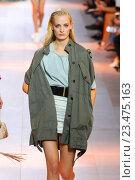 Купить «MILAN, ITALY - SEPTEMBER 26: A model walks the runway during the Roberto Cavalli fashion show as part of Milan Fashion Week Spring/Summer 2016 on September 26, 2015 in Milan, Italy.», фото № 23475163, снято 26 сентября 2015 г. (c) Anton Oparin / Фотобанк Лори