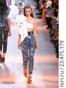 Купить «MILAN, ITALY - SEPTEMBER 26: A model walks the runway during the Roberto Cavalli fashion show as part of Milan Fashion Week Spring/Summer 2016 on September 26, 2015 in Milan, Italy.», фото № 23475179, снято 26 сентября 2015 г. (c) Anton Oparin / Фотобанк Лори