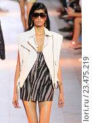 Купить «MILAN, ITALY - SEPTEMBER 26: A model walks the runway during the Roberto Cavalli fashion show as part of Milan Fashion Week Spring/Summer 2016 on September 26, 2015 in Milan, Italy.», фото № 23475219, снято 26 сентября 2015 г. (c) Anton Oparin / Фотобанк Лори