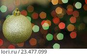 Купить «Золотой шар вращается на фоне боке», видеоролик № 23477099, снято 18 ноября 2015 г. (c) Александр Багно / Фотобанк Лори
