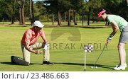 Купить «Two golfer players playing golf together », видеоролик № 23486663, снято 22 июля 2019 г. (c) Wavebreak Media / Фотобанк Лори