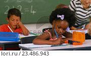 Купить «School kids doing their homework», видеоролик № 23486943, снято 4 апреля 2020 г. (c) Wavebreak Media / Фотобанк Лори
