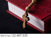 Bible and cross in religious concept. Стоковое фото, фотограф Elnur / Фотобанк Лори
