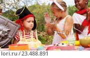 Купить «Group of kids in various costumes celebrating birthday», видеоролик № 23488891, снято 15 июля 2019 г. (c) Wavebreak Media / Фотобанк Лори