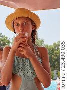 Купить «Portrait of girl are drinkig fresh juice, summer mountain landscape», фото № 23490035, снято 3 августа 2016 г. (c) Кравецкий Геннадий / Фотобанк Лори