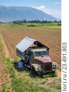 Купить «Shed converted from old lorry used by farm workers near Korca, in southeastern Albania,.», фото № 23491803, снято 27 июня 2016 г. (c) age Fotostock / Фотобанк Лори