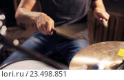 Купить «male musician playing drums and cymbals at concert», видеоролик № 23498851, снято 25 августа 2016 г. (c) Syda Productions / Фотобанк Лори