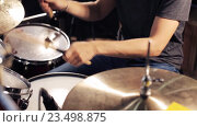 Купить «male musician playing drums and cymbals at concert», видеоролик № 23498875, снято 26 августа 2016 г. (c) Syda Productions / Фотобанк Лори