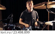 Купить «male musician playing drums and cymbals at concert», видеоролик № 23498899, снято 25 августа 2016 г. (c) Syda Productions / Фотобанк Лори