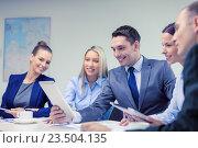 Купить «business team with tablet pc having discussion», фото № 23504135, снято 9 ноября 2013 г. (c) Syda Productions / Фотобанк Лори
