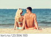 Купить «happy couple in swimwear sitting on summer beach», фото № 23504183, снято 11 августа 2015 г. (c) Syda Productions / Фотобанк Лори