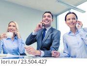 Купить «business team with smartphones having conversation», фото № 23504427, снято 9 ноября 2013 г. (c) Syda Productions / Фотобанк Лори