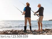 Купить «Senior man fishing with his grandson», фото № 23509039, снято 15 апреля 2015 г. (c) Sergey Nivens / Фотобанк Лори