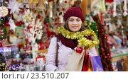 Купить «Portrait of female customer», видеоролик № 23510207, снято 2 декабря 2015 г. (c) Яков Филимонов / Фотобанк Лори