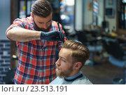 Купить «Customer with hairdresser», фото № 23513191, снято 23 марта 2016 г. (c) Raev Denis / Фотобанк Лори