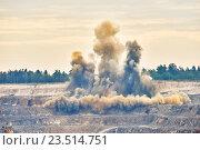 Купить «Explosion blast in open cast mining quarry mine», фото № 23514751, снято 9 сентября 2016 г. (c) Дмитрий Калиновский / Фотобанк Лори