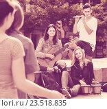 Купить «Portrait of four teenagers playing music together outdoors», фото № 23518835, снято 7 июля 2020 г. (c) Яков Филимонов / Фотобанк Лори