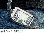 Купить «Сто долларов в кармане синих джинсов», фото № 23519191, снято 7 декабря 2015 г. (c) Сергеев Валерий / Фотобанк Лори