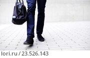 Купить «young man with bag walking along city street», видеоролик № 23526143, снято 26 августа 2016 г. (c) Syda Productions / Фотобанк Лори