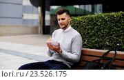 Купить «man with notebook or diary writing on city street», видеоролик № 23526175, снято 26 августа 2016 г. (c) Syda Productions / Фотобанк Лори