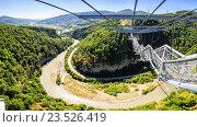 Купить «Панорама SKYPARK AJ Hackett Сочи - самый длинный в мире подвесной пешеходный мост СкайБридж, первый в России парк приключений на высоте от основателя банджи-джампинга Эй Джей Хаккетта», фото № 23526419, снято 22 мая 2016 г. (c) Ирина Мойсеева / Фотобанк Лори