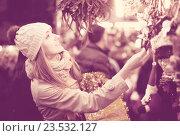 Купить «Girl shopping at festive fair», фото № 23532127, снято 27 января 2020 г. (c) Яков Филимонов / Фотобанк Лори