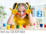 Купить «Portrait of child girl with face and hands painted», фото № 23537023, снято 28 января 2015 г. (c) Оксана Кузьмина / Фотобанк Лори