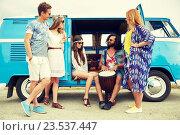 Купить «hippie friends with tom-tom playing music over car», фото № 23537447, снято 27 августа 2015 г. (c) Syda Productions / Фотобанк Лори