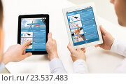 Купить «close up of hands with business news on tablet pc», фото № 23537483, снято 10 мая 2014 г. (c) Syda Productions / Фотобанк Лори
